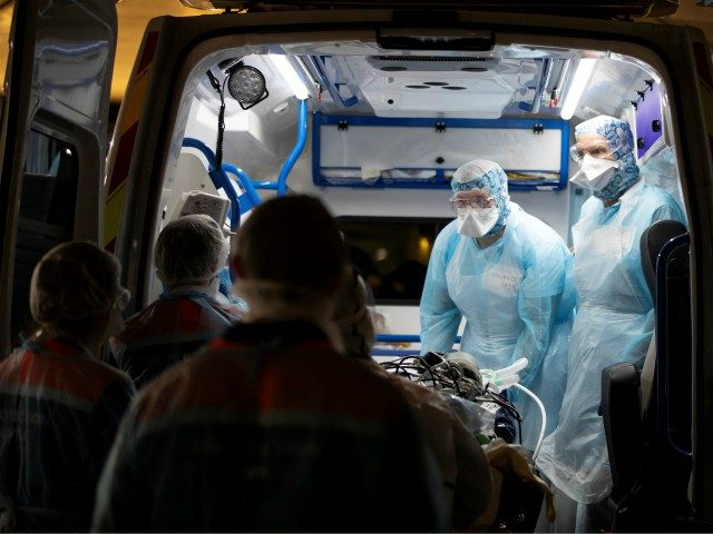 Medical staff disembark from ambulances patients infected with the COVID-19 at the Gare d'Austerlitz train station on April 1, 2020 in Paris as part of the evacuation of 36 patients in two separate medical TGV towards hospitals of Brittany, western France, where the outbreak of the Covid-19 pandemic caused by …