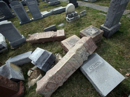 FILE - In this Feb. 27, 2017 file photo, headstones toppled and damaged by vandals lie on the ground at Mount Carmel Cemetery in Philadelphia. The Anti-Defamation League is reporting a 57 percent increase in anti-Semitic incidents in the U.S. in 2017, the highest tally that the Jewish civil rights …
