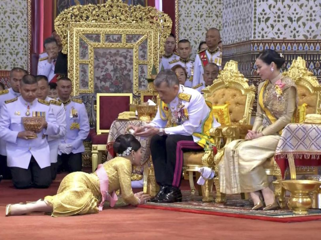 In this image made from video, Thailand's King Maha Vajiralongkorn, center, and Queen Suthida, right, attend the second of a three-day coronation ceremony for Thai King Maha Vajiralongkorn that includes bestowing of the royal title and granting of ranks to members of royalty at Grand Palace in Bangkok, Sunday, May …