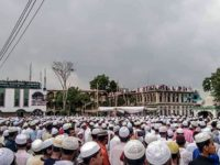 Muslim devotees attend a funeral prayer for an Islamic preacher during a government-imposed nationwide lockdown as a preventive measure against the COVID-19 coronavirus, in Brahmanbaria also known as Sarail on April 18, 2020. - Tens of thousands of people defied a nationwide coronavirus lockdown in Bangladesh on April 18 to …