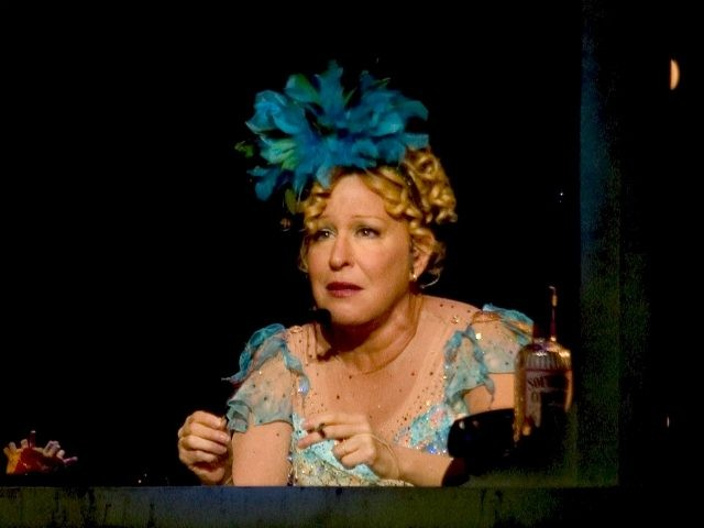 Bette Midler as her alter ego, Delores Delago, performs at the Verizon Wireless Arena in Manchester, N.H., Thursday, Sept. 30, 2004, as she begins the second part of her Kiss My Brass Tour. (AP Photo/Robert E. Klein)