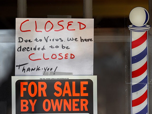 """For Sale By Owner"" and ""Closed Due to Virus"" signs are displayed in the window of Images On Mack in Grosse Pointe Woods, Mich., Thursday, April 2, 2020. The coronavirus outbreak has triggered a stunning collapse in the U.S. workforce with 10 million people losing their jobs in the past …"
