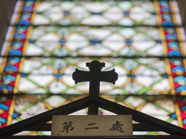 A cross is seen inside St. Joseph's church, also known as Wangfujing church in Beijing on January 25, 2018. / AFP PHOTO / Nicolas ASFOURI (Photo credit should read NICOLAS ASFOURI/AFP via Getty Images)