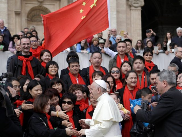 Pope Francis meets a group of faithful from China at the end of his weekly general audience in St. Peter's Square, at the Vatican, Wednesday, April 18, 2018. (AP Photo/Gregorio Borgia)
