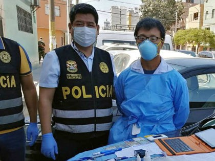 A Peruvian police photo showing Chinese citizen Zhang Tianxing (right) after his arrest for the unauthorised use of stolen COVID-19 tests in a street in Lima. (AFP Photo)