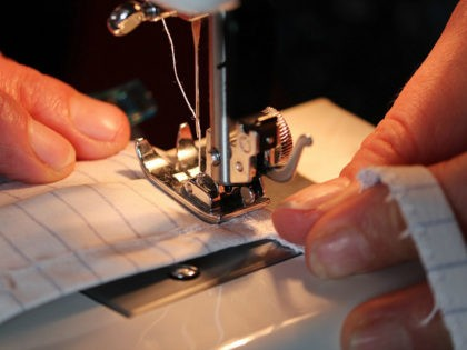 closeup sewing machine masks