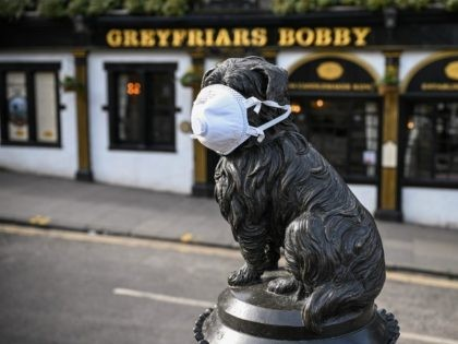 EDINBURGH, SCOTLAND - MARCH 23: Greyfriars Bobby statue has a mask placed on his face on March 23, 2020 in Edinburgh, Scotland. Coronavirus (COVID-19) has spread to at least 188 countries, claiming over 13,000 lives and infecting more than 300,000 people. There have now been 5,683 diagnosed cases in the …
