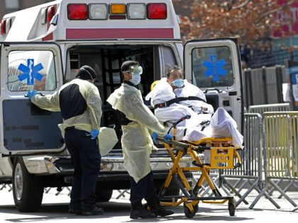 A patient is wheeled out of Elmhurst Hospital Center to a waiting ambulance, Tuesday, April 7, 2020, in the Queens borough of New York, during the current coronavirus outbreak. New York Gov. Andrew Cuomo said last week that as city hospitals fill up, some patients could be moved to other …