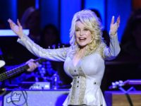 In this Saturday, Oct. 12, 2019, photo Dolly Parton performs at her 50th Opry Member Anniversary at the Grand Ole Opry in Nashville, Tenn. The73-year-old actress, singer and songwriter, who first played the Opry when she was just a teenager, celebrated her 50th anniversary as a Grand Ole Opry member …