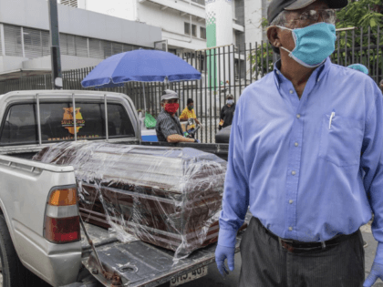 A coffin with the body of a recently deceased person sits in the bed of a pickup truck before burial, outside Teodoro Maldonado Hospital in Guayaquil, Ecuador, Monday, April 6, 2020. Guayaquil, a normally bustling city that has become a hot spot in Latin America as the coronavirus pandemic spreads, …