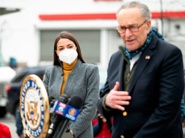 Senate Minority Leader Chuck Schumer speaks as Democratic Congresswoman from New York Alexandria Ocasio-Cortez wearing a face mask to protect herself from the coronavirus, listens during a press conference in the Corona neighbourhood of Queens on April 14, 2020 in New York City. - Senate Minority Leader Chuck Schumer and …