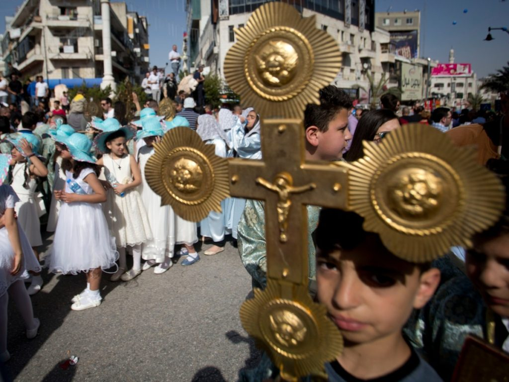 Palestinian Christians take part in the Holy Fire ceremony a day before Orthodox Easter in the West Bank city of Ramallah, Saturday, April 27, 2019.(AP Photo/Majdi Mohammed)