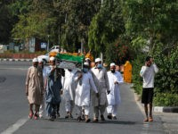 A group of Indian Muslims carry their relative who died due to natural reasons for burial during 21 day nationwide lockdown to control the spread of the new coronavirus New Delhi, India, Monday, April 13, 2020. The new coronavirus causes mild or moderate symptoms for most people, but for some, …