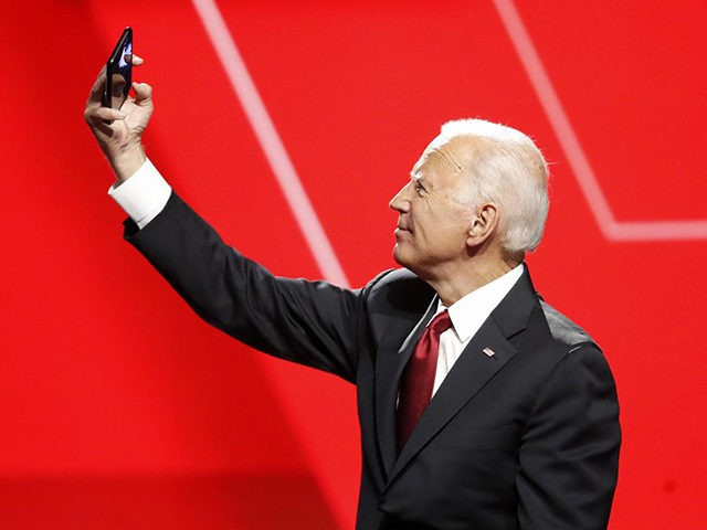 Democratic presidential candidate former Vice President Joe Biden takes a photo following a Democratic presidential primary debate hosted by CNN/New York Times at Otterbein University, Tuesday, Oct. 15, 2019, in Westerville, Ohio. (AP Photo/John Minchillo)