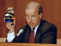 Sen. Joe Biden (D-Del.), chairman of the Senate Judiciary Committee holds up an explosive device during a hearing of the committee on Capitol Hill, April 22, 1993. The committee was holding hearings on terrorism in the United States. (AP Photo/Charles Tasnadi)