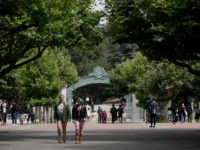 "People walk in front of Sather Gate on the University of California at Berkeley campus in Berkeley, Calif., Thursday, July 18, 2019. Soon students in Berkeley, California will have to pledge to ""collegiate Greek system residences"" instead of sororities or fraternities and city workers will have to refer to manholes …"
