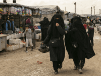 In this March 31, 2019 photo, women shop in a marketplace at Al-Hol camp, home to families of Islamic State fighters, in Hasakeh province, Syria. (AP Photo/Maya Alleruzzo)