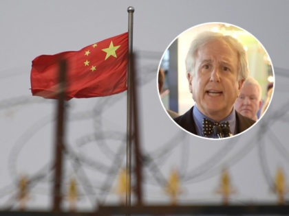 (INSET: Bloomberg News Editor-in-Chief Emeritus and co-founder Matthew Winkler) TOPSHOT - This photo taken on June 4, 2019 shows the Chinese flag behind razor wire at a housing compound in Yangisar, south of Kashgar, in China's western Xinjiang region. - A recurrence of the Urumqi riots which left nearly 200 …
