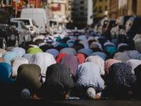 Muslims praying outside