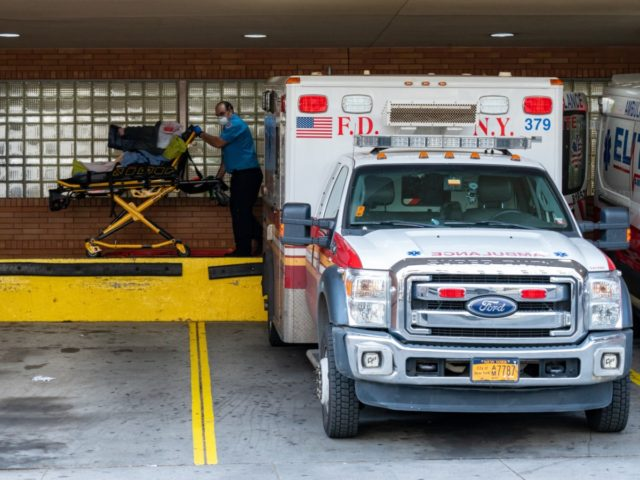 NEW YORK, NY - APRIL 7: A person is transported from an ambulance to the emergency room at Wyckoff Heights Medical Center on April 7, 2020 in New York, United States. Gov. Andrew M. Cuomo said on Tuesday in his daily briefing that 731 people had died since the prior …