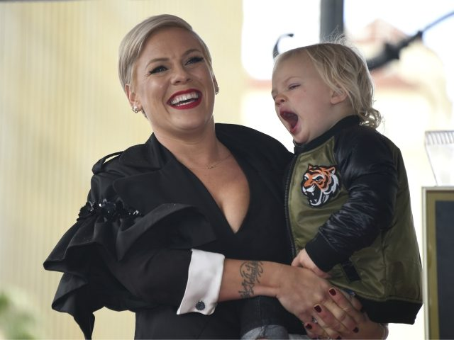 Pink holds son Jameson at a ceremony where the singer received a star on the Hollywood Walk of Fame on Tuesday, Feb. 5, 2019, in Los Angeles. (Photo by Phil McCarten/Invision/AP)