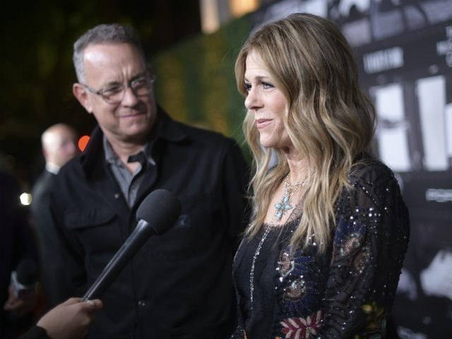 Tom Hanks, left, and Rita Wilson speak with journalists as they arrive at JONI 75: A Birthday Celebration on Wednesday, Nov. 7, 2018, at the Dorothy Chandler Pavilion in Los Angeles. (Photo by Richard Shotwell/Invision/AP)