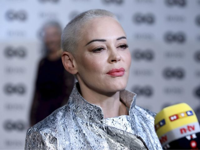 Actress Rose McGowan talks to press on arrival at the 'GQ Men of The Year' Awards, Wednesday, Sept. 5, 2018. (Photo by Grant Pollard/Invision/AP)