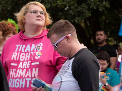 Members of the area's transgender and non-binary community gather for a transgender rights march through the city's Midtown district in Atlanta on Saturday, Oct. 12, 2019. The march was part of the annual Gay Pride Festival. (AP Photo/Robin Rayne)