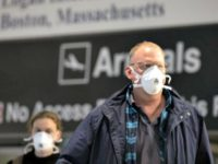 Passengers on a flight from Paris arrive at Logan International Airport in Boston, Friday, March, 13, 2020. Beginning at midnight Friday most Europeans will be banned from entering the United States for 30 days to try to slow down the spread of the coronavirus. Americans returning from Europe will be …