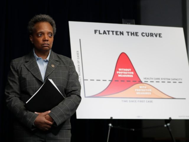 Chicago Mayor Lori Lightfoot attends a news conference where Illinois Gov. J.B. Pritzker announced a shelter in place order to combat the spread of the Covid-19 virus, Friday, March 20, 2020, in Chicago. (AP Photo/Charles Rex Arbogast)