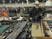 "FILE - In this Jan. 6, 2013 file photo, Ken Haiterman, of Pioneer Market, holds a CMMG 5.56mm AR 15 during the 2013 Rocky Mountain Gun Show in Sandy, Utah. A bipartisan quartet of senators, including two National Rifle Association members and two with ""F"" ratings from the potent firearms …"