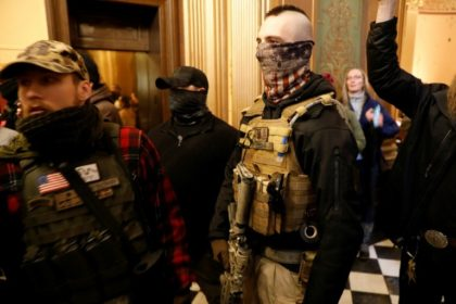 Armed US protesters enter Michigan capitol to demand lockdown end