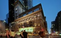 In this Aug. 3, 2007 file photo, the Carnegie Hall building at 57th St. and Broadway appears in New York. Carnegie Hall is projecting a $9 million operating deficit on its $104 million budget after canceling the rest of its season because of the coronavirus pandemic and anticipates making changes …