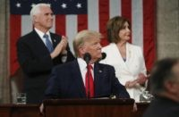 In this Feb. 4, 2020, file photo, President Donald Trump look to the first lady's box before delivering his State of the Union address to a joint session of Congress in the House Chamber on Capitol Hill in Washington, as Vice President Mike Pence and Speaker Nancy Pelosi watch. Trump …