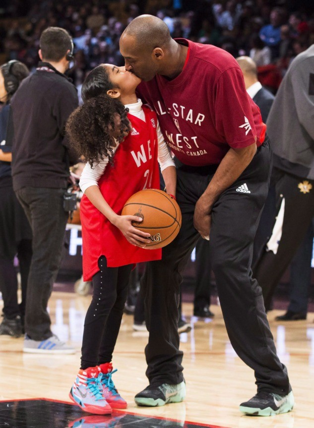 In this Feb. 14, 2016, file photo, Los Angeles Lakers Kobe Bryant (24) kisses his daughter Gianna on the court in warm-ups before first half NBA All-Star Game basketball action in Toronto. Bryant, his 13-year-old daughter, Gianna, and several others are dead after their helicopter went down in Southern California …
