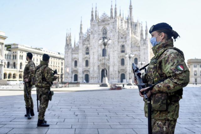 Soldiers patrol in front of the Duomo gothic cathedral in Milan, Italy, Sunday, April 5, 2020. The government is demanding Italians stay home and not take the leveling off of new coronavirus infections as a sign the emergency is over, following evidence that more and more Italians are relaxing restrictions …
