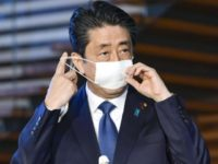 Japanese Prime Minister Shinzo Abe takes off mask as he speaks to reporters at the prime minister's official residence in Tokyo Monday, April 6, 2020. Abe said that he will declare a state of emergency for Tokyo and six other prefectures as early as Tuesday, April 7, to bolster measures …