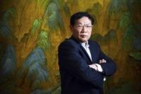 """In this Dec. 3, 2012, file photo, Chinese real estate mogul Ren Zhiqiang poses for a photo in his office in Beijing. Ren, a prominent Communist party member who criticized Chinese leader Xi Jinping's handling of the coronavirus outbreak is being investigated on suspicion of a """"severe violation of discipline …"""