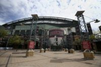 In this Thursday, March 26, 2020 file photo, The main entrance in front of Chase Field is devoid of activity in Phoenix. Putting all 30 teams in the Phoenix area this season and playing in empty ballparks was among the ideas discussed Monday, April 6, 2020 during a call among …