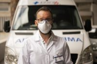 Doctor Sebastian Yancev, who participated in the operation to diagnose and treat passengers on the Australian Greg Mortimer cruise ship for the new coronavirus, poses for a photo in front of the ambulance that was used to move the patients to local hospitals in Montevideo, Uruguay, Tuesday, April 7, 2020. …