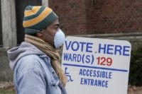 Voters masked against coronavirus line up at Riverside High School for Wisconsin's primary election Tuesday April 7, 2020, in Milwaukee. The new coronavirus causes mild or moderate symptoms for most people, but for some, especially older adults and people with existing health problems, it can cause more severe illness or …