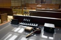 This Jan. 14, 2013, file photo shows a gavel sits on a desk inside the Court of Appeals at the Ralph L. Carr Colorado Judicial Center in Denver. The coronavirus pandemic has crippled the U.S. legal system, creating constitutional dilemmas as the accused miss their days in court. Judges from …
