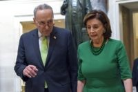 In this March 12, 2020, file photo Senate Minority Leader Sen. Chuck Schumer of N.Y., and House Speaker Nancy Pelosi of Calif., walks together as they head to a lunch with Irish Prime Minister Leo Varadkar on Capitol Hill in Washington. (AP Photo/Susan Walsh, File)
