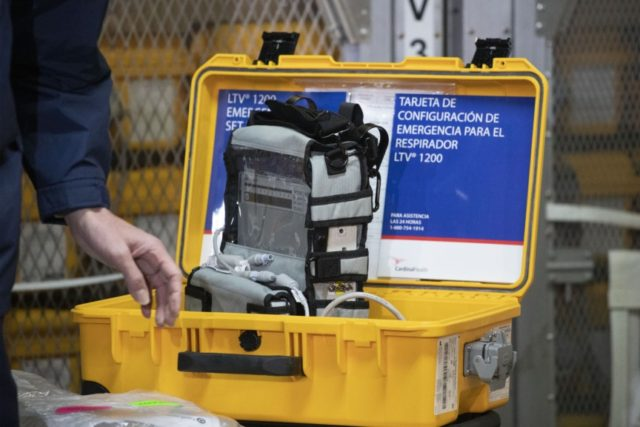 In this March 24, 2020, file photo a ventilator is displayed during a news conference at the New York City Emergency Management Warehouse, where 400 ventilators have arrived and will be distributed. As hospitals scour the country for scarce ventilators to treat critically ill patients stricken by the new coronavirus, …