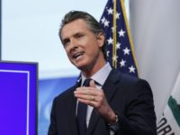"In this file photo taken Tuesday April 14, 2020, California Gov. Gavin Newsom discusses an outline for what it will take to lift coronavirus restrictions during a news conference at the Governor's Office of Emergency Services in Rancho Cordova, Calif. President Donald Trump declared that states could ""call your own …"