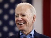 In this Feb. 22, 2020, file photo, Democratic presidential candidate former Vice President Joe Biden speaks during a caucus night event in Las Vegas. Biden's tenure as Barack Obama's vice president is complicating his efforts to deepen ties with Latinos who could be critical to winning the White House. For …