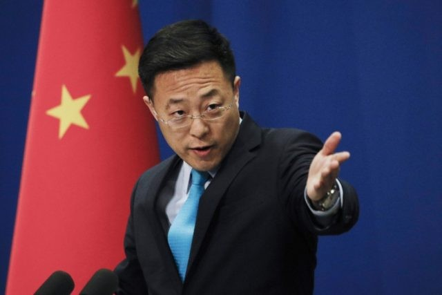 In this file photo taken Monday, Feb. 24, 2020, Chinese Foreign Ministry new spokesman Zhao Lijian gestures as he speaks during a daily briefing at the Ministry of Foreign Affairs office in Beijing. From Asia to Africa, London to Berlin, Chinese envoys have set off diplomatic firestorms with a combative …
