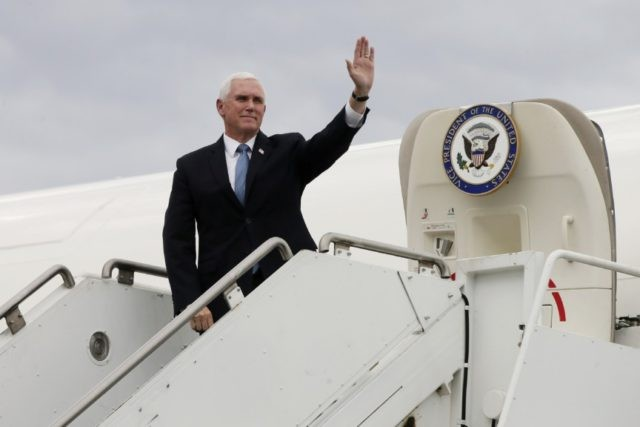 Vice President Mike Pence waves as he arrives for a visit to the Mayo Clinic Tuesday, April 28, 2020, in Rochester, Minn., where he toured the facilities supporting COVID-19 research and treatment. (AP Photo/Jim Mone)