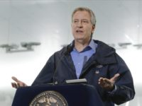 In this March 31, 2020 file photo, New York City Mayor Bill de Blasio speaks at the USTA Indoor Training Center where a 350-bed temporary hospital will be built in New York. De Blasio oversaw the dispersal of a large, tightly packed Hasidic Jewish funeral and lashed out at the …