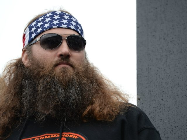 FORT WORTH, TX - APRIL 06: Reality TV personality Willie Robertson takes part in pre-race ceremonies for the NASCAR Sprint Cup Series Duck Commander 500 at Texas Motor Speedway on April 6, 2014 in Fort Worth, Texas. (Photo by Patrick Smith/Getty Images )